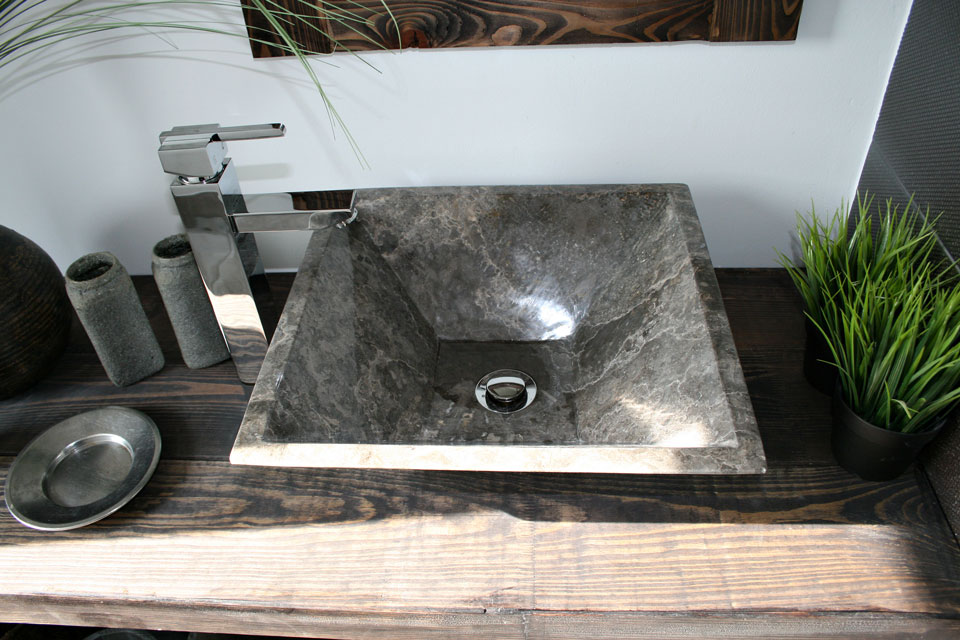 A well made dark concrete sink with texture