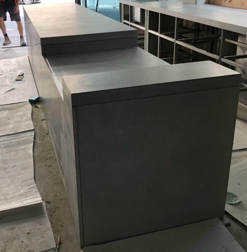 A concrete counter with a dug out section polished and prepared in the city cbd