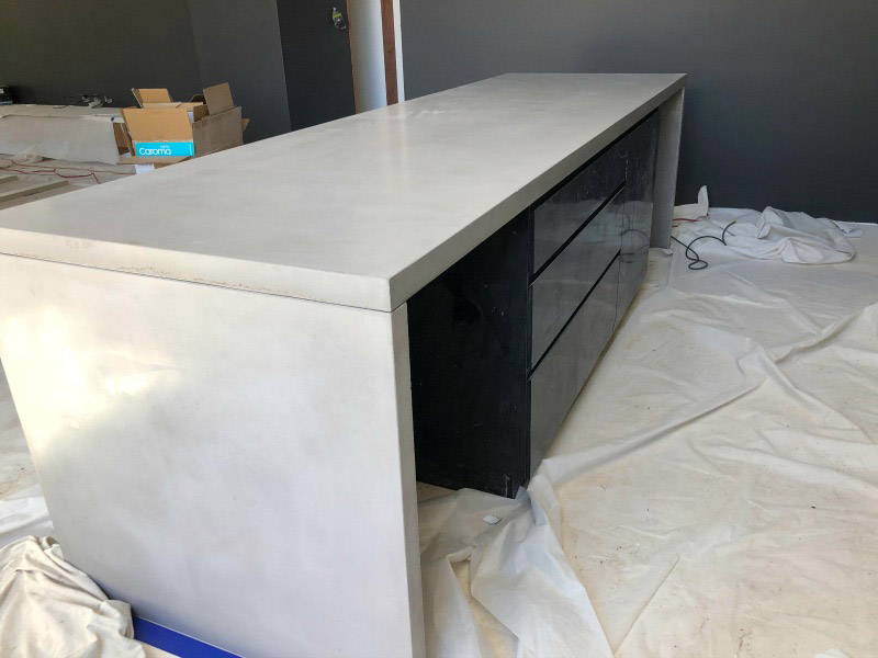 A concrete benchtop installation with lighter weight concrete with fibres in it