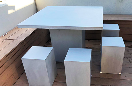 A concrete outdoor table manufactured in the shop and delivered to the customer